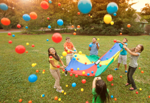 kids playing in park with colored balls